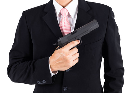 pull out: Businessman pull out gun concept for aggression