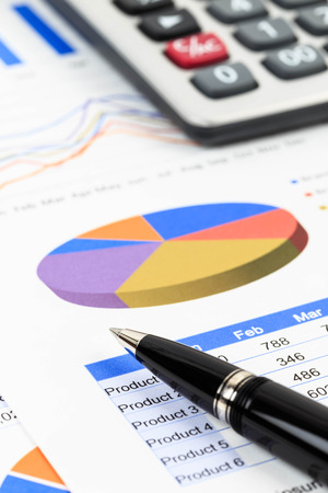 brand monitoring: Marketing report chart and graph analysis with pen and calculator Stock Photo