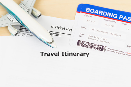 e ticket: Travel itinerary with copy space, plane model, and boarding pass