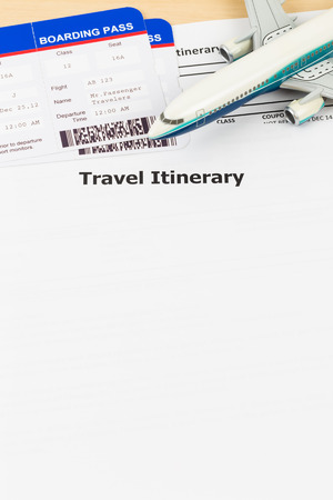 itinerary: Travel itinerary with copy space, plane model, and boarding pass;  document and boarding pass are mock-up