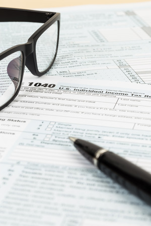 Tax form with glasses, and pen