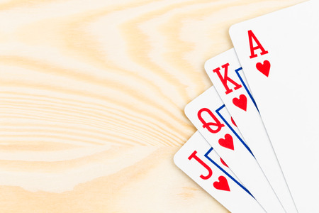 royal background: Royal flush poker playing cards on wooden background
