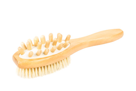 massager: Wooden massager and bath brush on white background