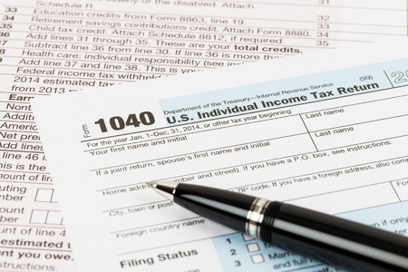 Tax form with pen taxation concept Stock Photo