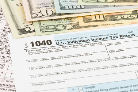 Tax form with banknote taxation concept Stock Photo