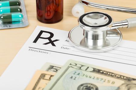 doctor money: Blank prescription, stethoscope, banknote, and medicine