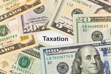 Taxation and dollar banknote tax concept Stock Photo