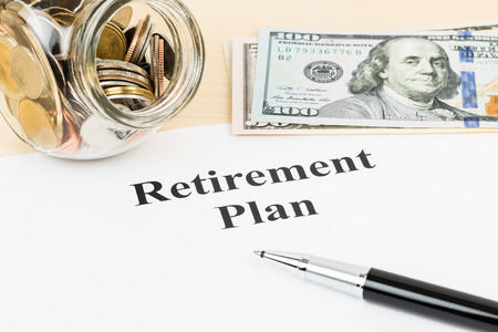 Retirement plan with banknote, coin jar, and pen