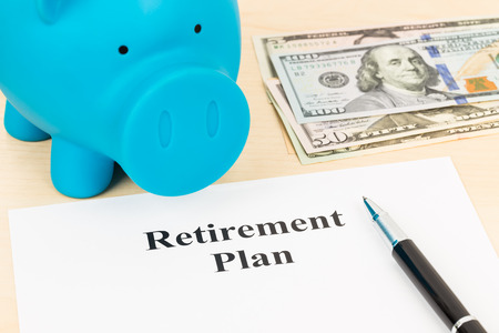 retiring: Retirement plan with banknote, piggy bank, and pen