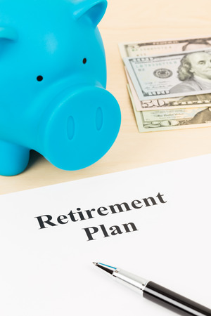 Retirement plan with banknote, piggy bank, and pen photo
