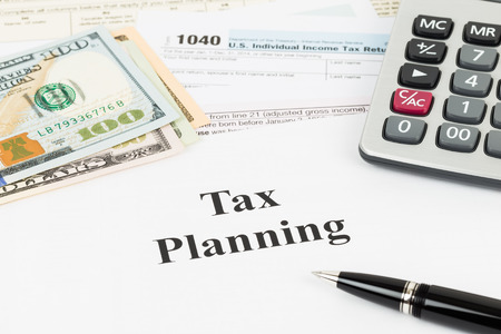 Tax planning wirh calculator and dollar banknote taxation concept
