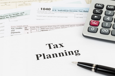 taxation: Tax planning wirh calculator taxation concept Stock Photo