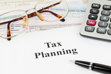 Tax planning wirh calculator and glasses taxation concept