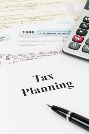 Tax planning wirh calculator taxation concept Stock Photo