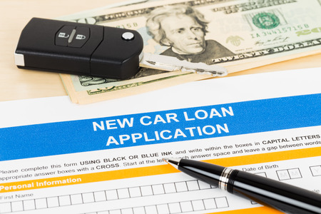 borrowing: Car loan application with car key and dollar banknote; form is mock-up