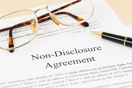 disclosure: Non disclosure agreement document with pen and glasses; document is mock-up Stock Photo