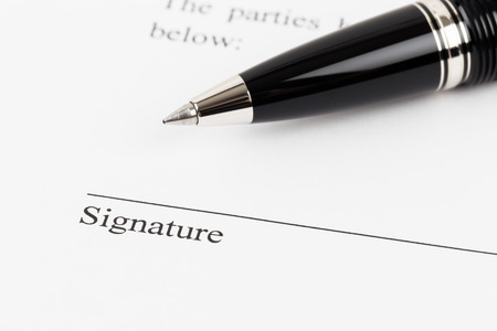 acknowledgment: Signature field on document with pen Stock Photo