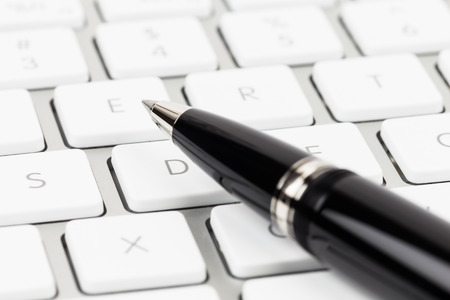 Pen on keyboard concept blog writer Stock Photo - 39176985