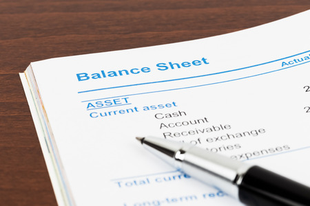 stockholder: Balance sheet in stockholder report book, document is mock-up