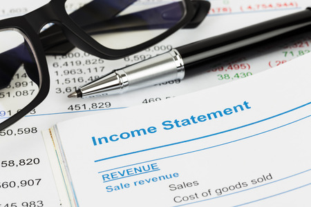 stockholder: Income statement in stockholder report book; document are mock-up Stock Photo