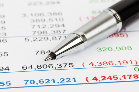 financial statement: Financial Statement report focus on pen; document is mock-up