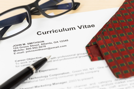 Curriculum vitae or CV with pen glasses and neck tie CV and information are mockup.