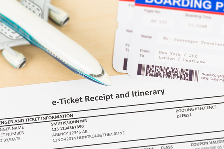 flight booking: Eticket with plane model and boarding pass these documents are mockup