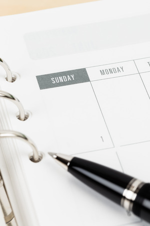 organizer page: Pen on calendar page organizer notebook