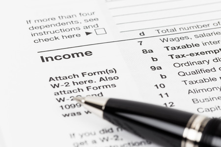 Income tax concept with pen