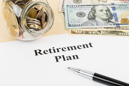 retiring: Retirement plan with banknote coin jar and pen Stock Photo