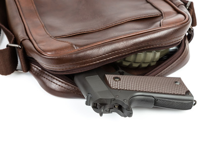 to conceal: Brown messenger bag with gun and grenade hidden Stock Photo