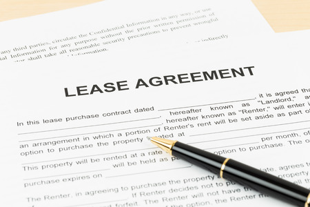 Lease agreement with pen document is mockup