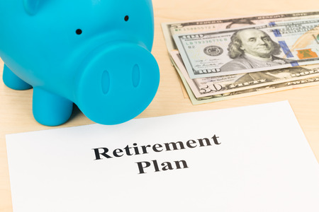 retiring: Retirement plan with banknote piggy bank and pen