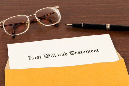 decease: Last will on cream color paper with glasses and pen in envelope document and information are mockup Stock Photo
