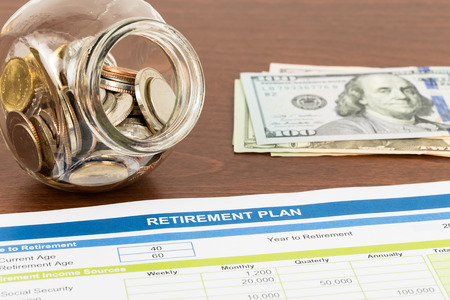 retiring: Retirement plan with money document is mockup