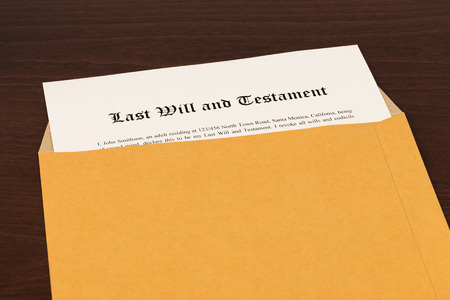 decease: Last will on cream color paper in opened  envelope Stock Photo
