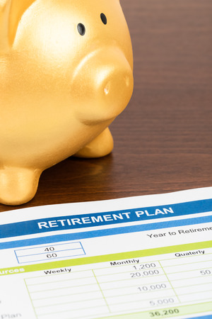 Retirement plan with piggy bank document is mockup photo
