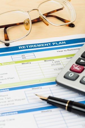 Retirement plan with glasses pen and calculator document is mockup photo