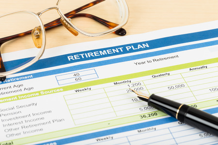 retiring: Retirement plan with glasses and pen document is mockup