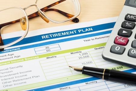 financial goals: Retirement plan with glasses pen and calculator document is mockup Stock Photo
