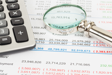 Financial Statement report with calculator and magnifier document is mockup Standard-Bild