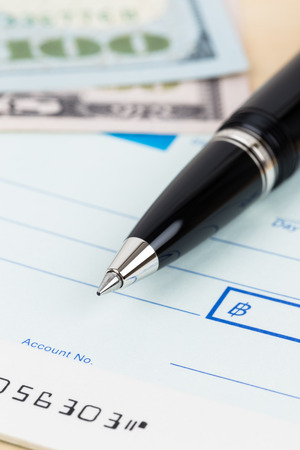 checkbook: Check with pen and banknote