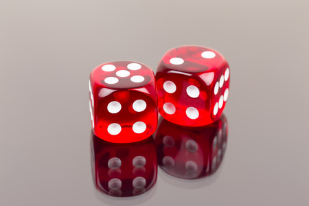 red dice: Two red dice with reflection