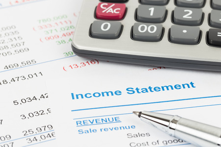 Income Statement report with calculator; document is mock-up Stock Photo
