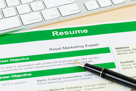 Resume with keyboard and pen; resume and information are mock-up