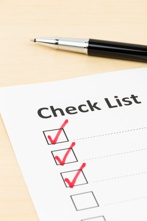 mark pen: Checklist paper with tick mark and pen