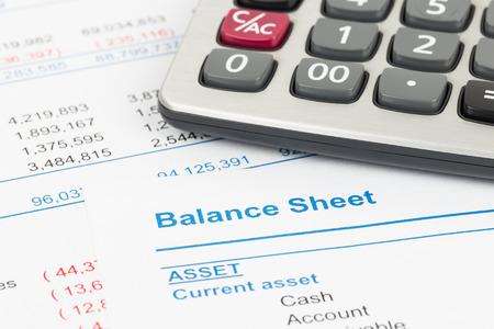 Balance sheet report with calculator; document is mock-up Standard-Bild