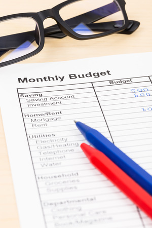 Home budget planning sheet with pen and glasses Stock Photo