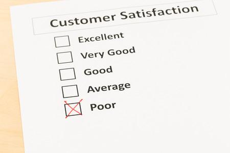 checkbox: Customer satisfaction survey checkbox with poor tick Stock Photo