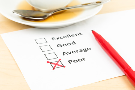 Customer satisfaction survey checkbox with poor tick Stock Photo